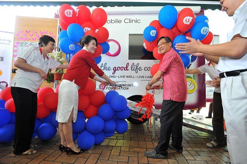 The Good Life Co-operative (TGLC) chairman Carol Tan with Health Minister Gan Kim Yong (third from left) launching the Wellness Bus Programme, a collaboration between the grassroots organisations in Aljunied GRC and Hougang SMC and TGLC, at The Seran