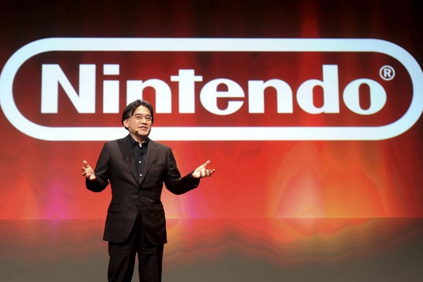 Satoru Iwata, president of Nintendo Co., gives a keynote speech at a game developers conference in San Francisco, California, U.S., on March 2, 2011.