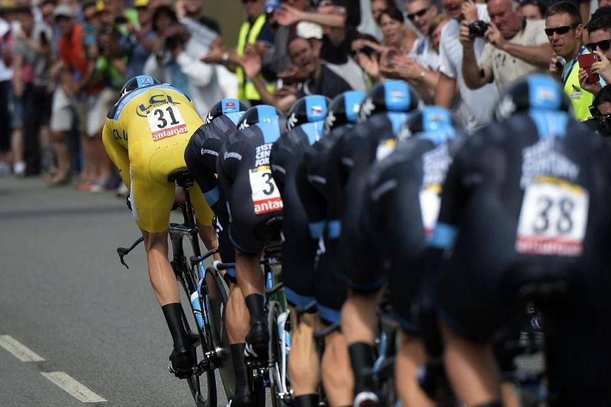 Riders of the Great Britain's Sky cycling team, including Great Britain's Christopher Froome, wearing the overall leader's yellow jersey, compete in the 28 km team time-trial, the ninth stage of the 102nd edition of the Tour de France cycling race on