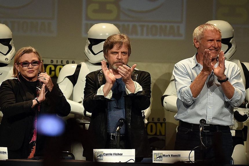 Stars from the original Star Wars (from right) Carrie Fisher, Mark Hamill and Harrison Ford at the Lucasfilm panel during Comic-Con International.