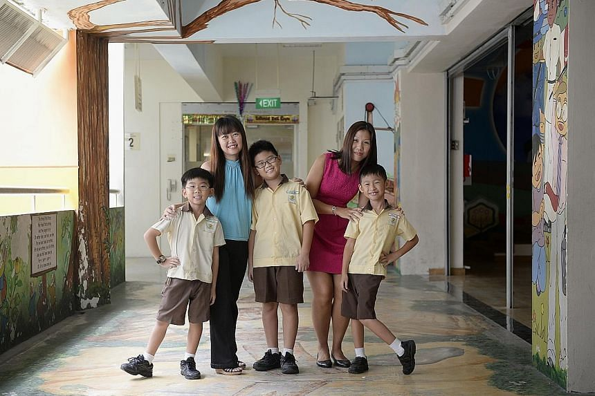 Justified joy: (from left) Madam Joanna Foo, 40 - with Joshua, eight, and Josiah, 11 - and Madam Joanne Tan, 32 - with Jerald, seven - are very pleased they picked Bendemeer Primary for their children.