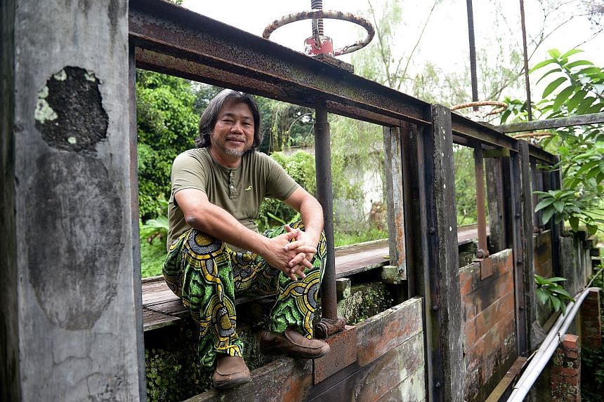 """Mr Tay Lai Hock (left) founded his eco-community to create a """"21st century kampung culture"""" here."""