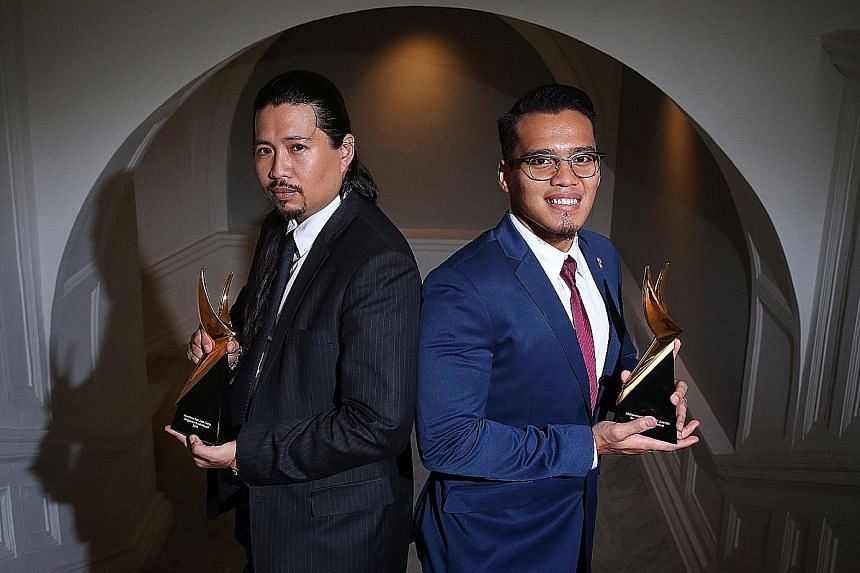 Lawyer Josephus Tan, 35 (left), and silat star Muhammad Shakir Juanda, 26, were among five people who received the Singapore Youth Award at the Victoria Concert Hall yesterday.