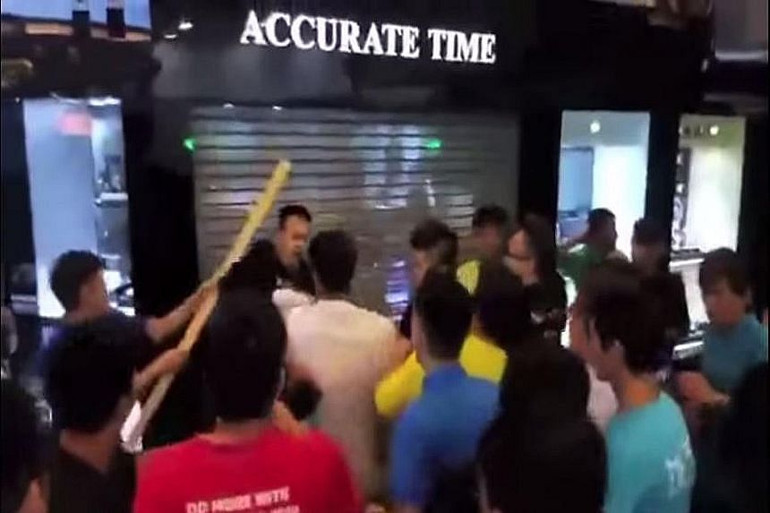 The ensuing brawl brought the mall to a standstill.