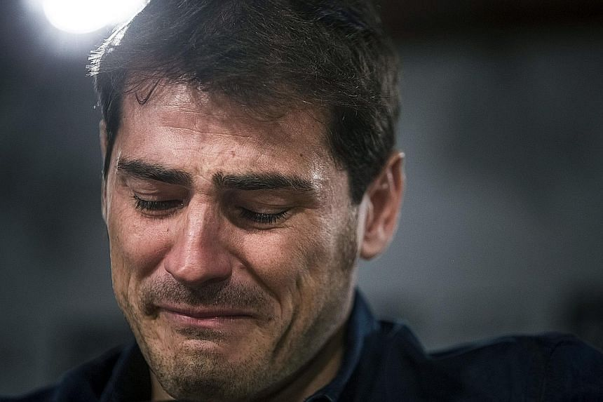 Real Madrid goalkeeper Iker Casillas is moved as he addresses a farewell press conference at the Santiago Bernabeu stadium in Madrid yesterday. Casillas, who joined Real's youth academy in 1990 and played 725 games for the club, will join Portuguese