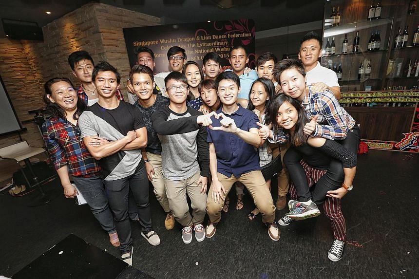 Members of the national wushu team enjoying the chance to let their hair down during last night's celebration dinner by the Singapore Wushu Dragon & Lion Dance Federation at Temasek Club. The Republic's exponents bagged six golds at the 28th SEA Game