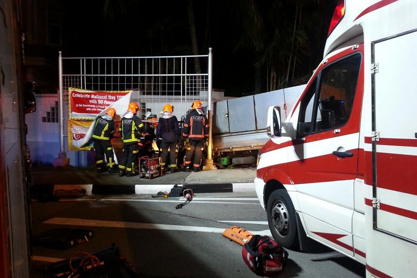 SCDF personnel working to rescue the trapped lorry driver.