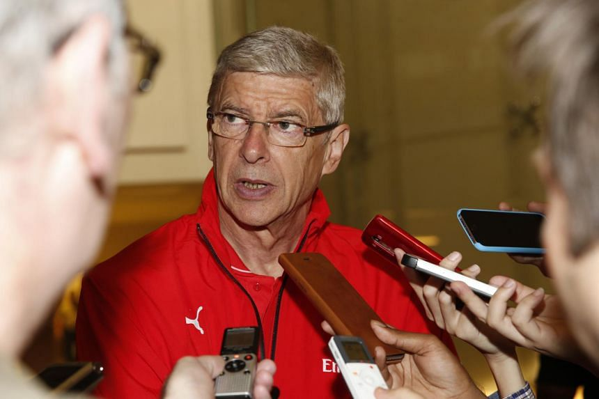 Arsenal manager Arsene Wenger speaking to the media after his team's arrival in Singapore on Monday.