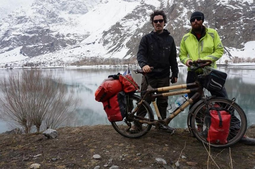Tom Roberts and Nicholas Moore on the Pamir Highway, a road through the Pamir Mountains through Central Asia, in March 2015.