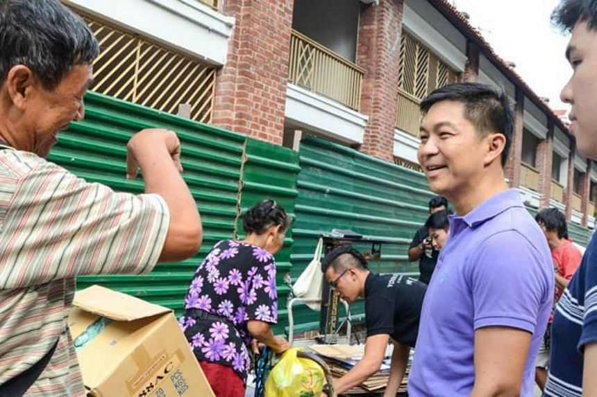 Minister Tan interacting with the cardboard collectors in Jalan Besar.