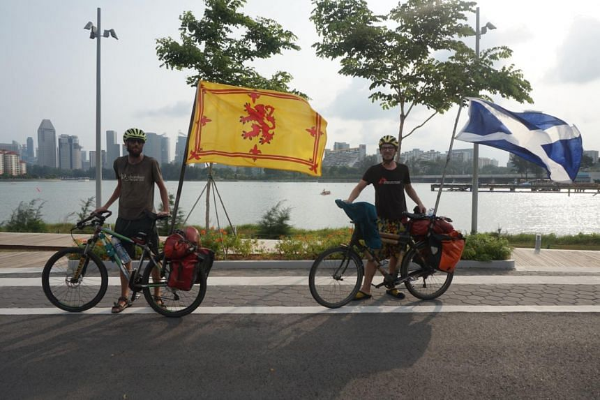 Scottish doctors Tom Roberts and Nicholas Moore, who cycled from London, after they arrived in Singapore on Monday, July 13, 2015.