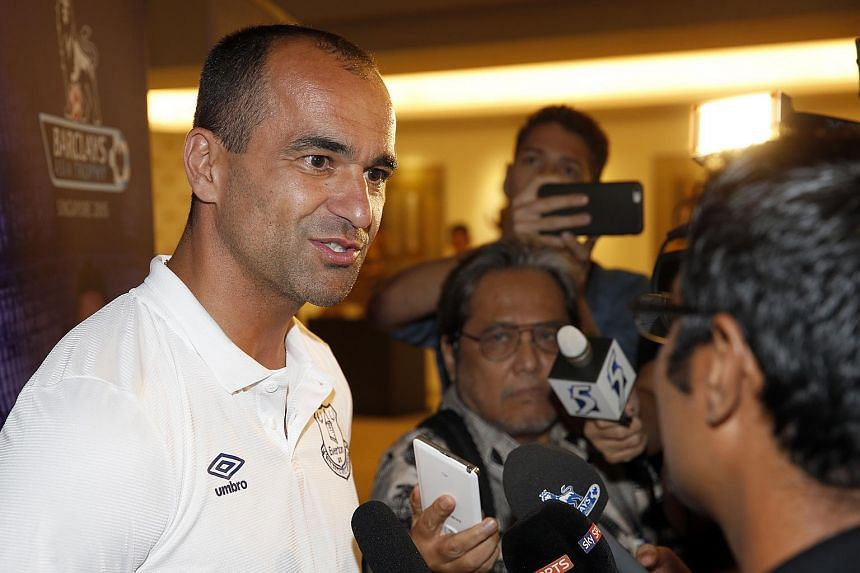 Everton manager Roberto Martinez speaking to the media upon his team's arrival in Singapore.