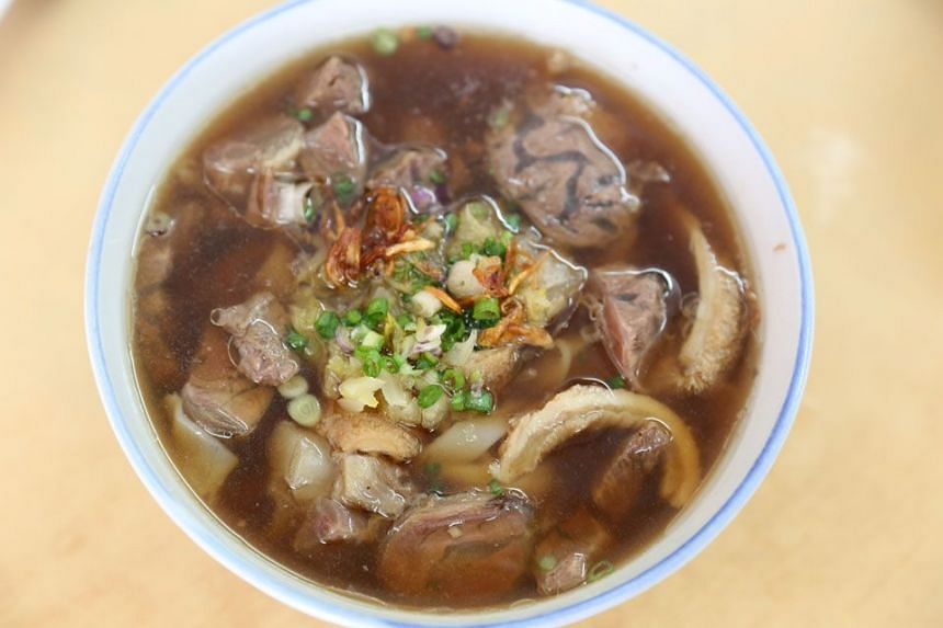 KLUANG INSTITUTIONS: Tangkak Beef's friendly lady boss; its bowl of signature beefy broth has a pleasant herbal accent and is piled with everything from beef slices, tender tripe and other innards.