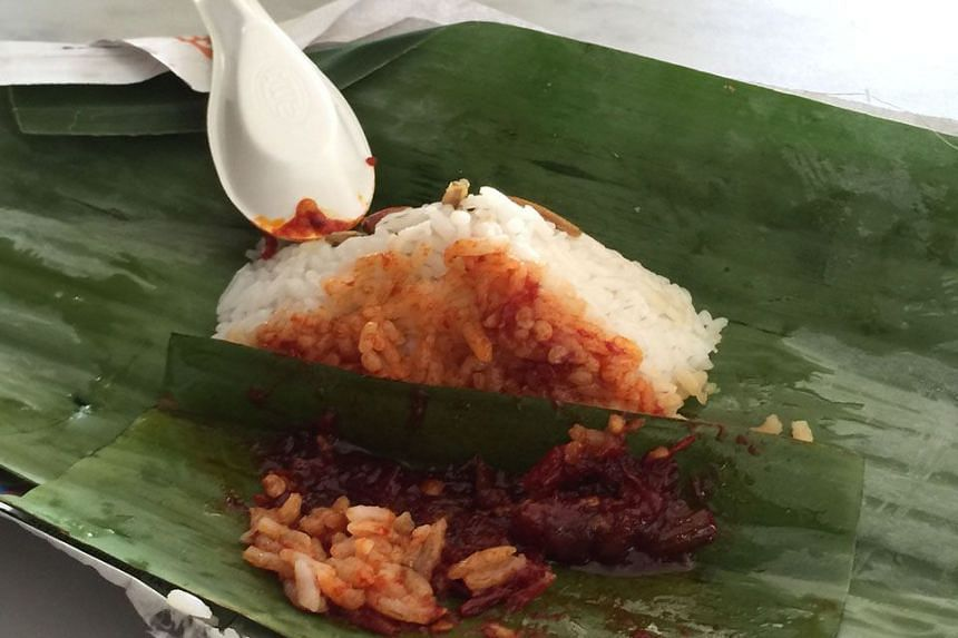 KLUANG INSTITUTIONS: Kluang Station Coffee's baby packet of rice and sambal with a sprinkling of crispy ikan bilis and peanuts wrapped in banana leaf costs just 80 sen.