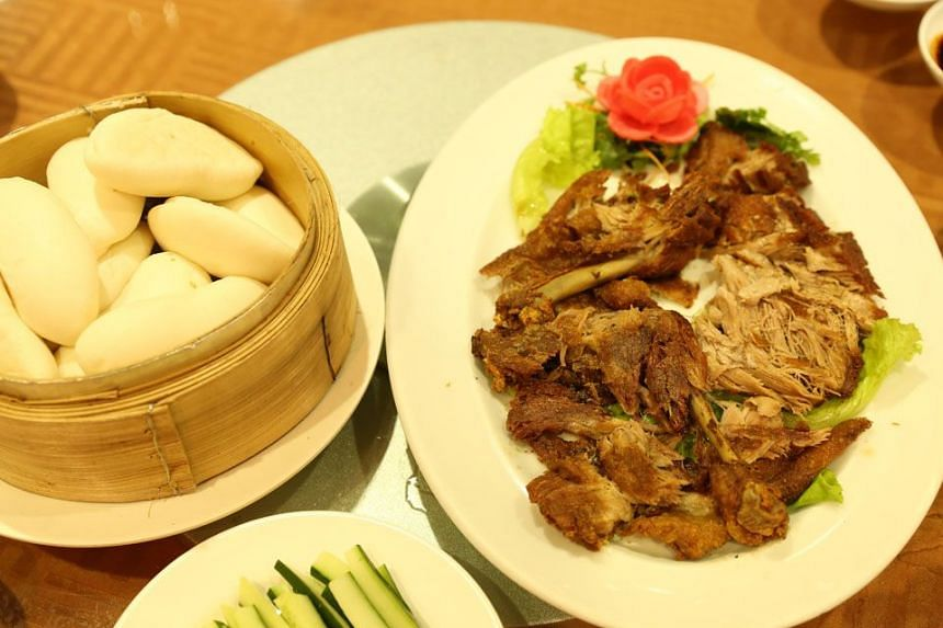 HOMESPUN GOODNESS: Star Restaurant's white cooked free range chicken (above) and shredded crispy roast duck to be stuffed into a steamed bun with cucumber strips and hoisin sauce.