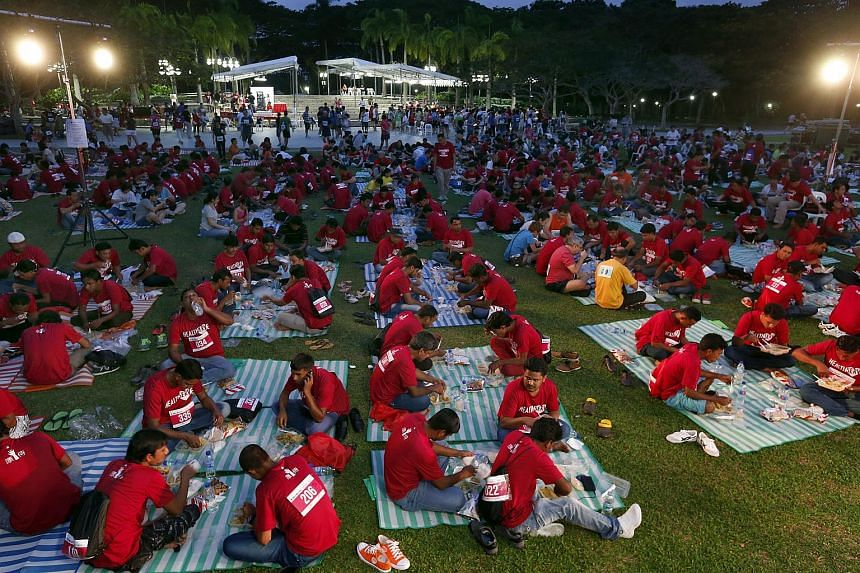 Close to 300 foreign workers breaking fast at Pasir Ris Park on July 12, 2015. The event which included a walk and a concert was organised by the Paya Lebar Methodist Church and NGO Healthserve.
