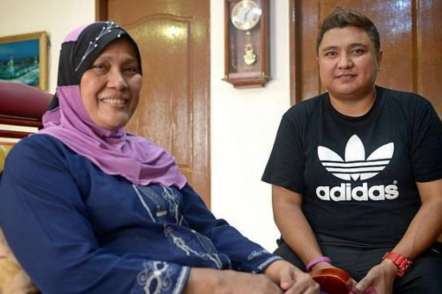 Mr Faizaltulamri Noorali with Ms Hasnah Shasdan, whom he helped evacuate from the fire. Among the others he took to safety was a 76-year-old woman who uses a wheelchair; he carried her down 11 flights of stairs.