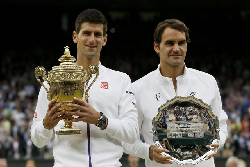Djokovic and his beaten rival Roger Federer parade their trophies.