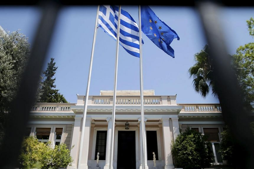 The Greek and European Union flags outside the Prime Minister's offices in Athens.