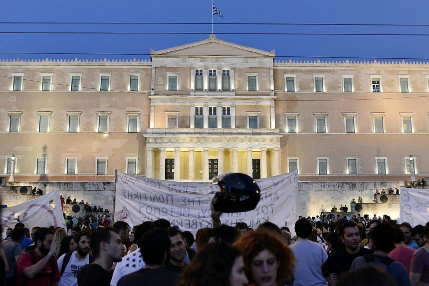 Greek riot police stand on the steps leading up to the parliament building in Athens.