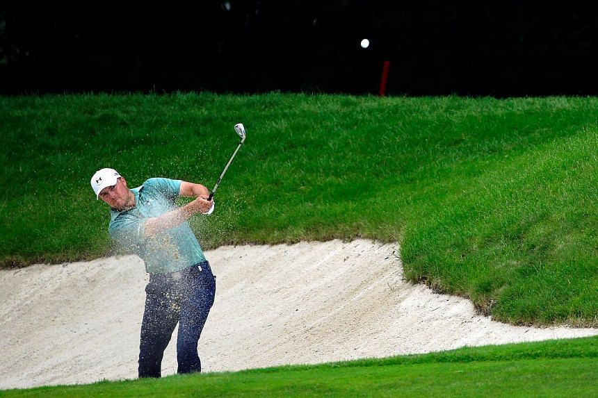 Jordan Spieth takes a shot from a bunker on the eighth hole during the final round of the John Deere Classic held at TPC Deere Run on July 12, 2015.