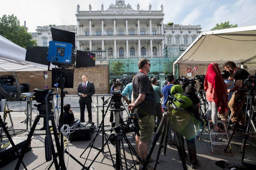 Media waiting outside of Vienna's Palais Coburg Hotel, where the Iran nuclear talks meetings are being held.