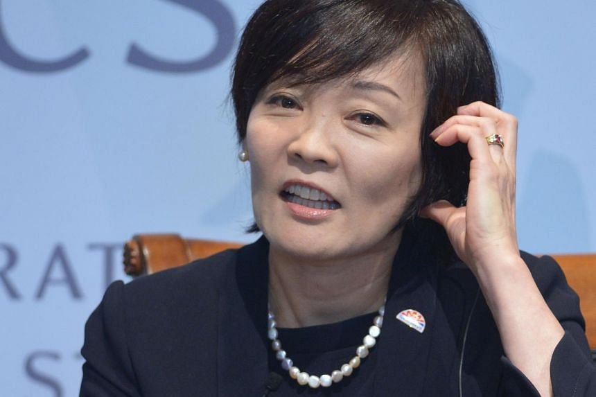 Akie Abe, the wife of Japan's Prime Minister Shinzo Abe, adjusting her earpiece during a discussion at the Centre for Strategic and International Studies (CSIS) in Washington, DC.