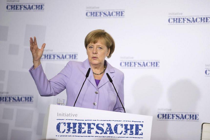German Chancellor Angela Merkel speaks during a meeting on the role of women in leadership in Berlin, Germany, on July 13, 2015.
