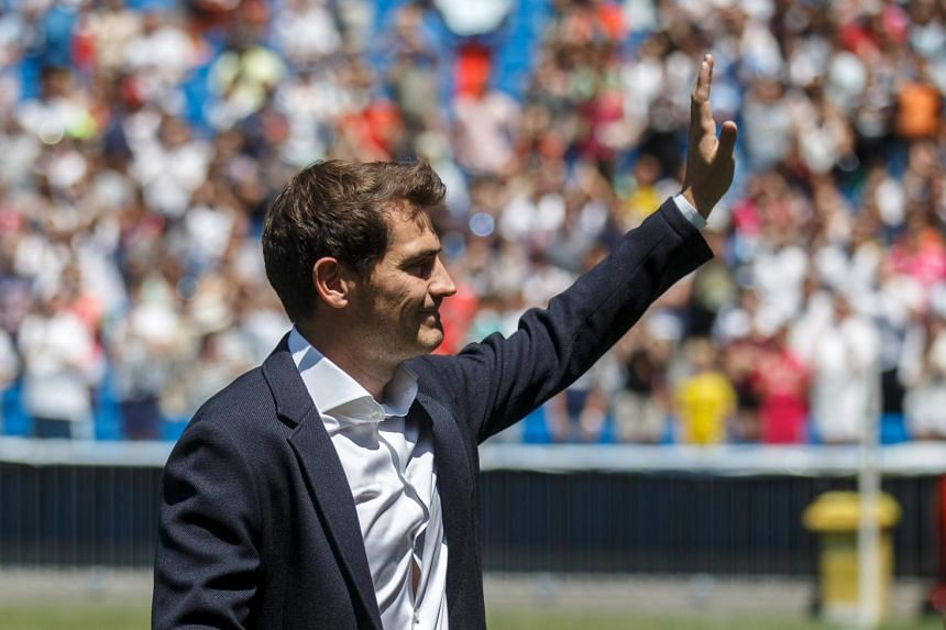 Departing Real Madrid captain and goalkeeper Iker Casillas waves to supporters at an official send-off at the Bernabeu stadium in Madrid, Spain, on July 13, 2015.