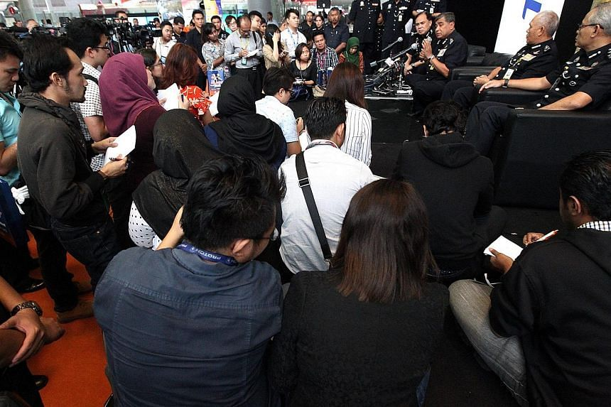 Malaysia's Inspector-General of Police Tan Sri Khalid Abu Bakar being surrounded by the media at KL Sentral in Kuala Lumpur.