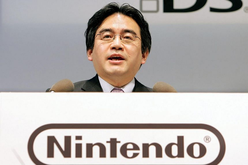 Satoru Iwata, president of Japan's Nintendo, speaks at a press conference to unveil the portable DS Lite game console in Tokyo.