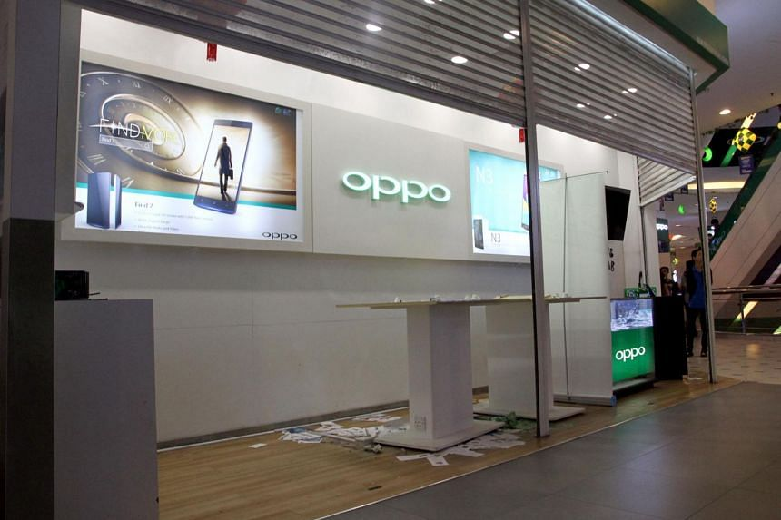 Police said an incident last Saturday at a mall's smartphone shop (above) spiralled out of control when a group of men tried to take revenge on the shop assistant who had caught an alleged shoplifter.