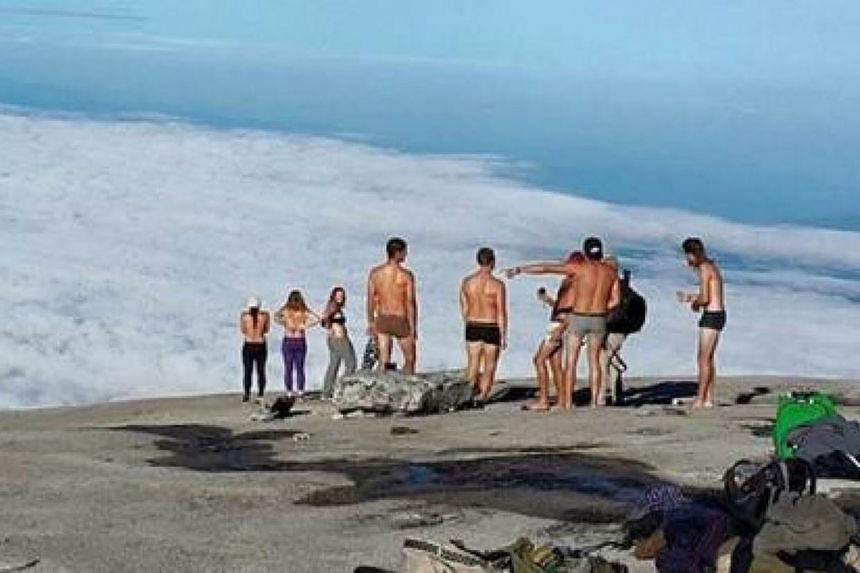Tourists stripping and taking photos of themselves on Mount Kinabalu, Malaysia.