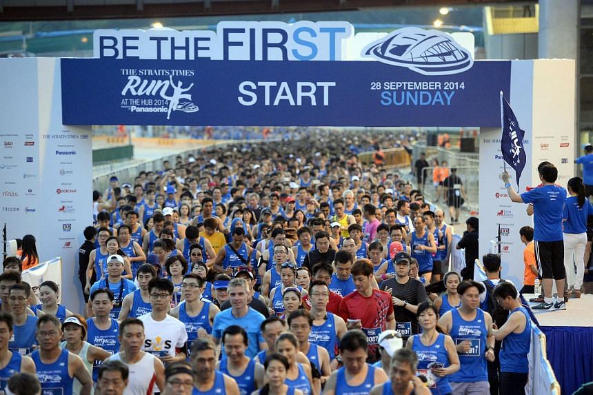 Participants starting off at The Straits Times Run at the Hub on Sept 28, 2014.