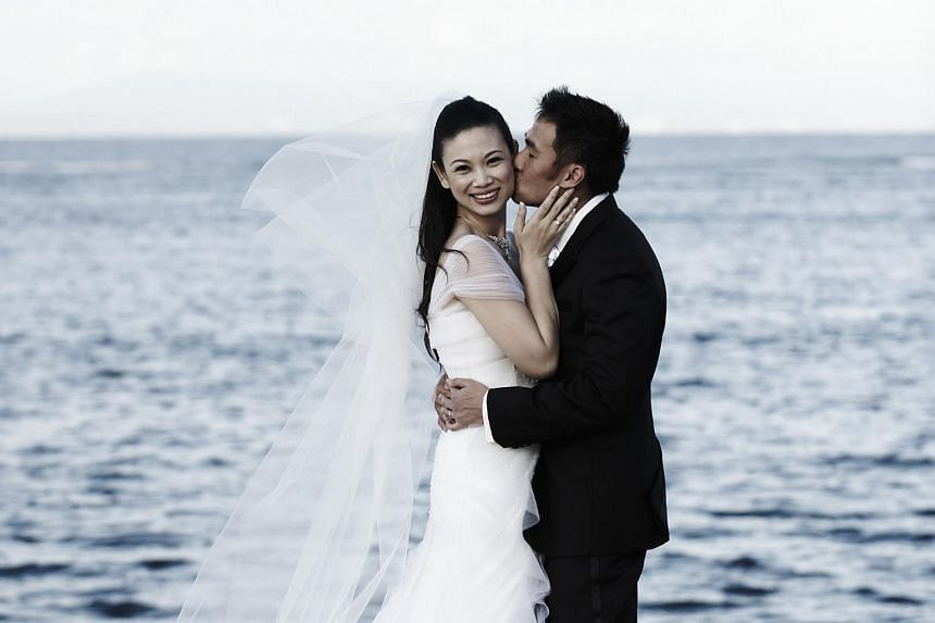 Ms Lee with her husband John Lim on their wedding day held in Bali in 2008.