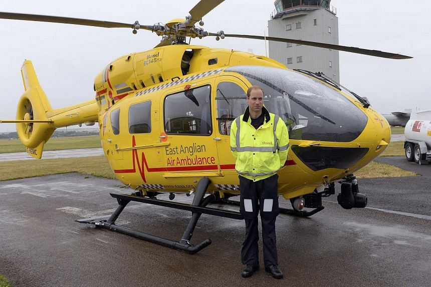 Britain's Prince William as he begins his new job as a co-pilot with the East Anglian Air Ambulance (EAAA) at Cambridge Airport, Britain on July 13, 2015.