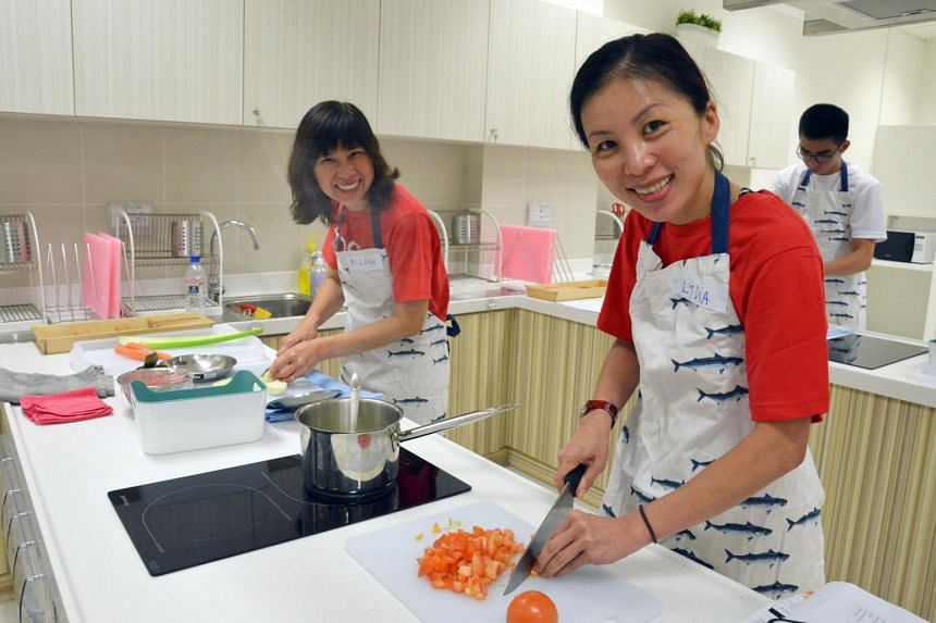 OCBC Cycle 2015 participants attempting to make Bolognese sauce at a nutrition workshop conducted by Singapore Sports Institute's (SSI) Dieticians on April 25, 2015.