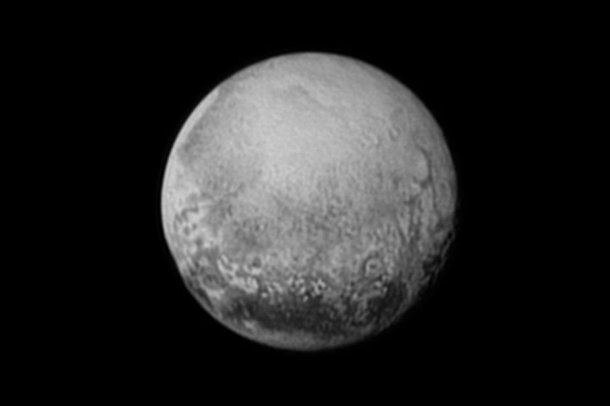 Pluto is pictured from a million miles away in this handout image from New Horizons' Long Range Reconnaissance Imager (LORRI).