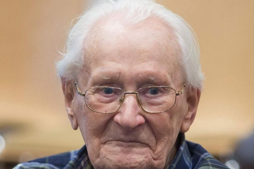 """Oskar Groening, defendant and former Nazi SS officer dubbed the """"bookkeeper of Auschwitz"""", sits in the courtroom prior to the continuation of his trial in Lueneburg, Germany, on July 14, 2015."""