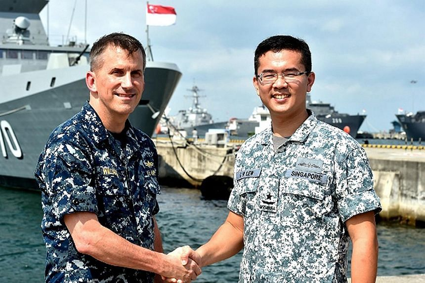RSN Fleet commander Lew Chuen Hong (right) meeting US Navy Commander Logistics Group Western Pacific Charles Williams yesterday.