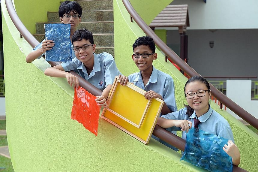Bukit View Secondary students (from left) Law Zehnwen, Yasmin Sim, Jeralyn Neo and Evangeline Bernice Meshach, all 15, won in the food category with a self-heating lunch box powered by energy from cycling.