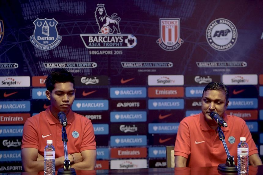 Singapore Selection goalkeeper Izwan Mahbud (left) and team manager V. Sundramoorthy speaking at a press conference ahead of the Barclays Asia Trophy match.
