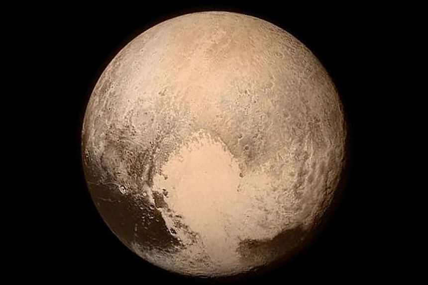 This photo obtained on July 14, 2015 from Nasa shows New Horizons' look at Pluto's Charon-facing hemisphere on July 11, 2015 revealing intriguing geologic details that are of keen interest to mission scientists.