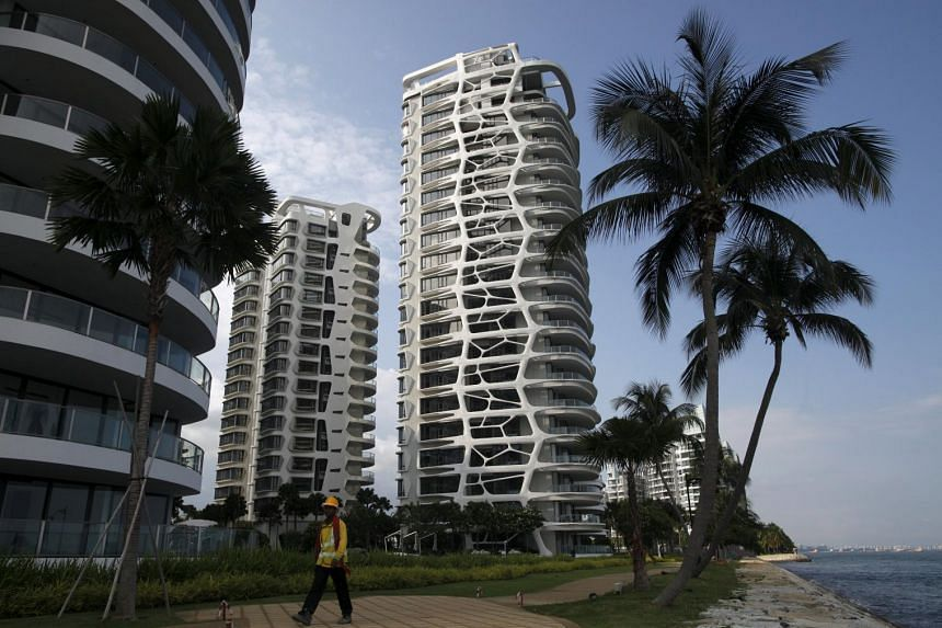 A file photo of a condominium in Singapore's Sentosa island. Resales of homes in Singapore have soared to almost half of all the private residential property transactions in the city-state, forcing developers to consider cutting prices as a flood of