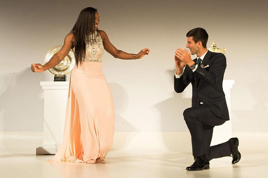 Novak Djokovic (right) and Serena Williams dancing on stage at the Wimbledon Champions Dinner at the Guild Hall in London, Britain.