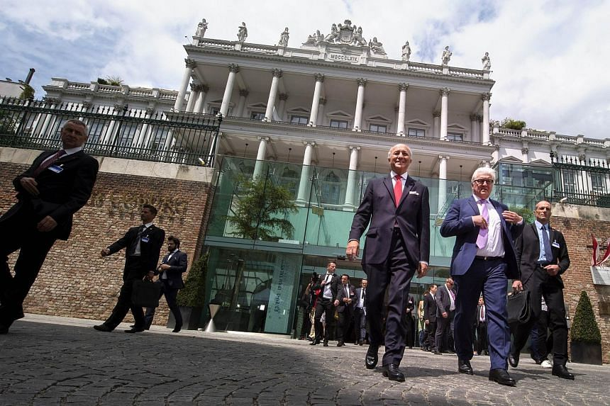 French Foreign Minister Laurent Fabius (left) and German Minister for Foreign Affairs Frank-Walter Steinmeier arrive at the Palais Coburg Hotel, where the Iran nuclear talks are being held on July 13, 2015.