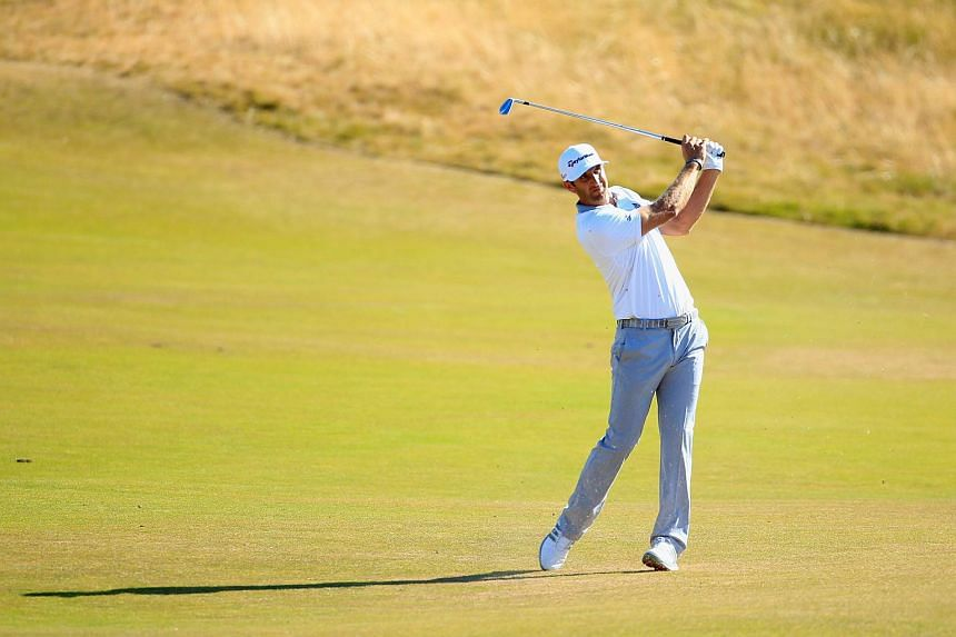 Dustin Johnson hits a shot during the final round of the 115th US Open Championship at Chambers Bay.