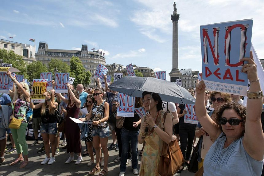 Protesters rallying to encourage Greeks to vote against the upcoming bailout referendum, at London's Trafalgar Square.