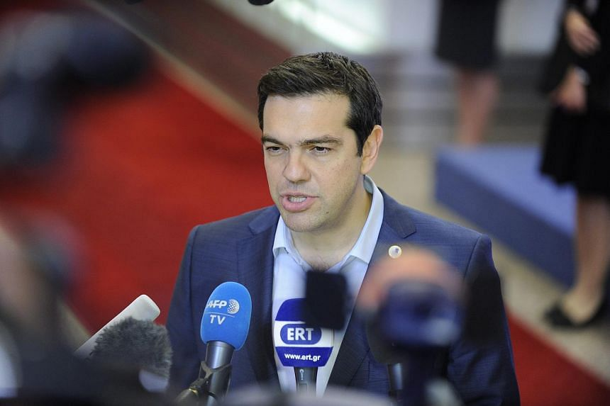 Greek Prime Minister Alexis Tsipras speaking at a press conference after the Eurozone leader summit in Brussels.