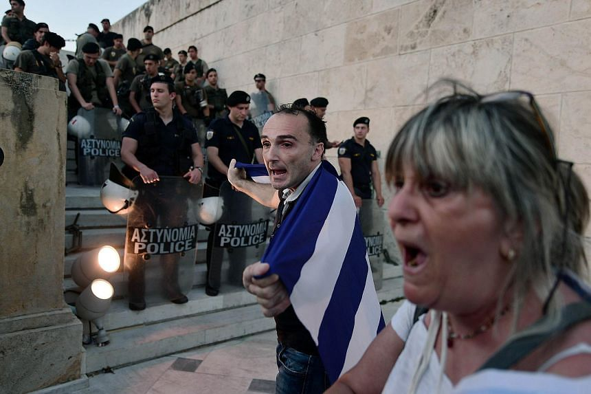 People demonstrating in front of the Greek parliament in Athens.